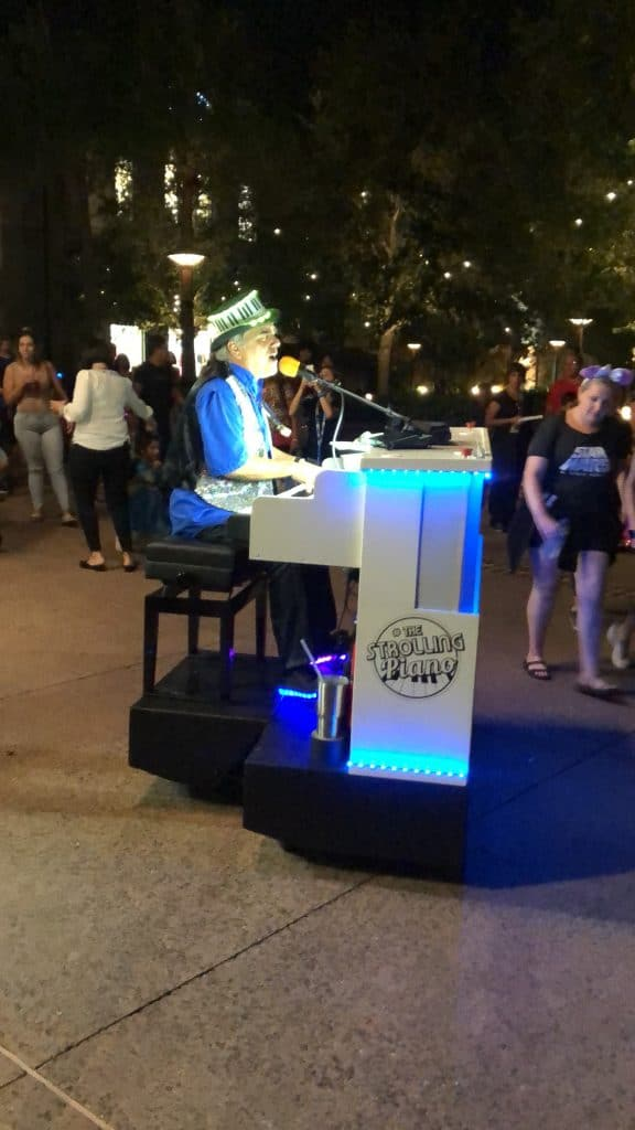 disney springs traveling piano player