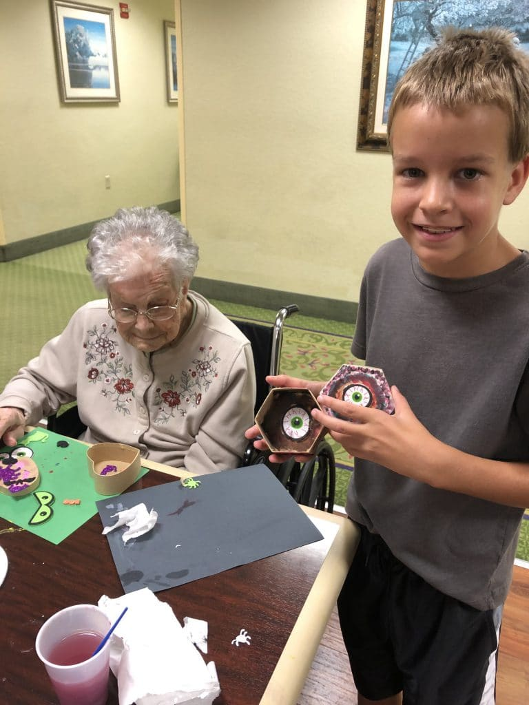 volunteering with kids at nursing home